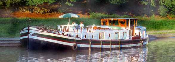 Hotel barge cruises on the Canal du Midi, southern France.
